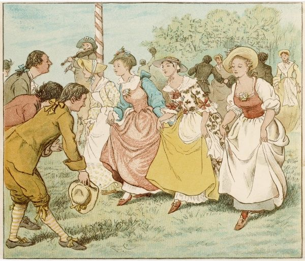 Traditional country dancing on the village green to the music of a fiddle player standing at a maypole