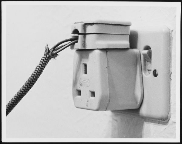 A badly wired plug, liable to give anyone a nasty electric shock
