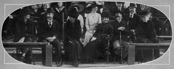 A candid photograph of Queen Alexandra and her family, laughing together at a sporting event in Copenhagen