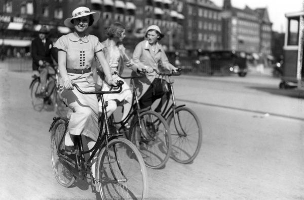 Ladies cycling in Copenhagen, Denmark, where simply EVERYONE goes awheel nowadays. Date: 1930s