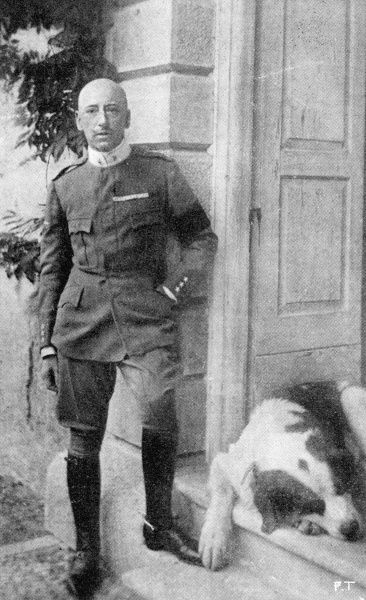 GABRIELE D'ANNUNZIO Italian writer, freshly decorated for his wartime achievements, with a dog of a size appropriate to his heroic self-image