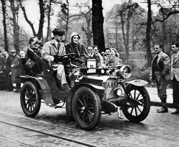 Photograph showing Mr. R.D. Gregory driving his 1904 15-h.p. Darracq car up Brixton Hill, during the Royal Automobile Club's veteran car run from London to Brighton, 14th November 1948