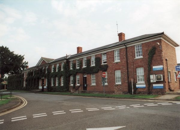 The main block of the Daventry Union Workhouse, Northamptonshire. The buildings, opened in 1837, were designed by John Plowman. The site later became Danetre Hospital. Date: 2000