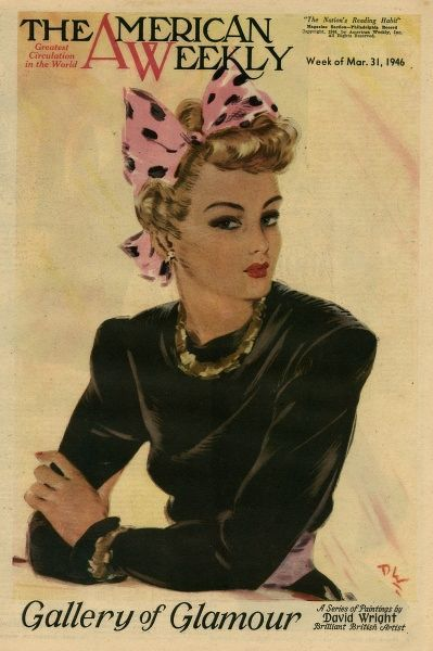 Elegant woman in a black top, with a pink and black bow in her hair and gold jewellery