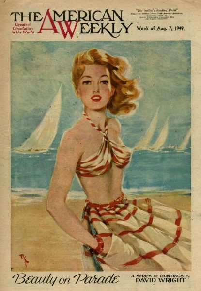 Elegant woman in red and white striped beachwear, standing on a beach with the sea and sailing boats in the background