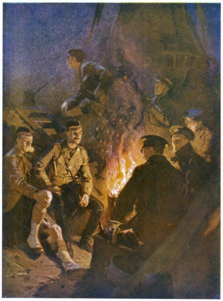 Men of a Scottish regiment enjoy the warmth of a fire in their trench before the day's fighting recommences