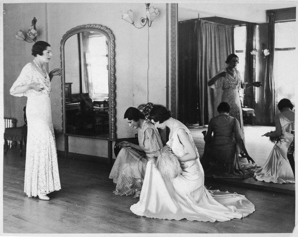 Experts in the manner and methods of bowing are busily engaged in instructing debutantes for the May Courts, which are to be held at Buckingham Palace