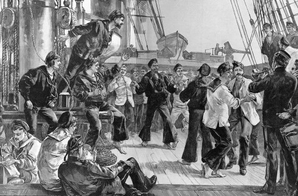 Engraving showing the deck of a Victorian warship, with the crew off duty, entitled 'Hands to Dance and Skylark'. Sailors smoking, dancing and playing musical instruments all across the gun deck