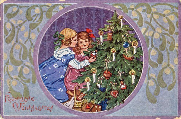Two girls dress the tree with ornaments and presents
