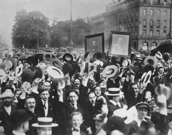 Street scene showing people (mostly men) at a demonstration in Vienna, Austria, to celebrate the alliance between Austria and Germany on the outbreak of the First World War