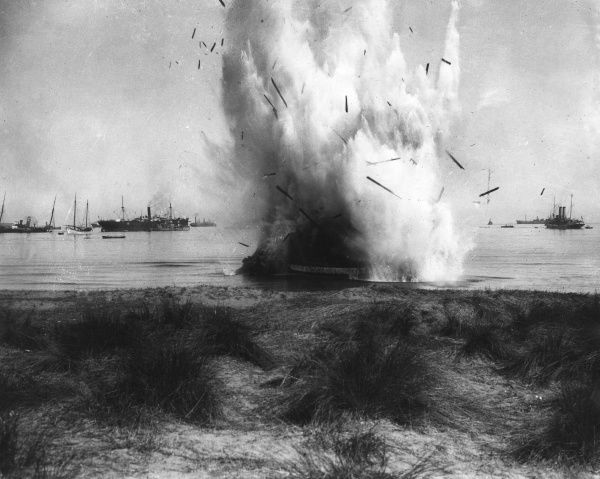 A derelict ship being blown up during the First World War. Date: 1914-1918