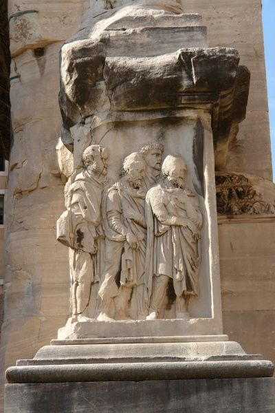 Detail of a bas relief sculpture on the Arch of Septimius Severus in Rome, Italy, depicting four human figures. This is a white marble triumphal arch in the Roman Forum, dedicated in AD 203 to commemorate the Parthian victories of Emperor Septimius Severus