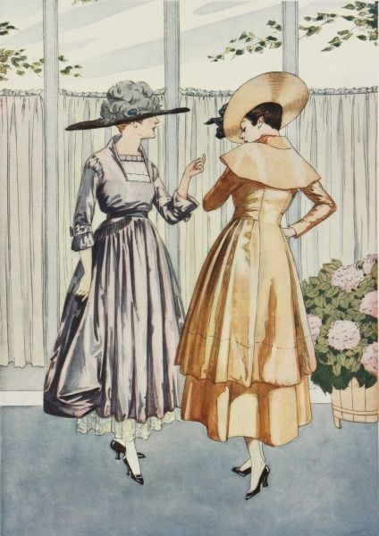 Two elegantly attired women pose in the latest Parisian summer fashions. Dresses feature the high waisted, full-skirted style typical of the World War One period, and are completed by matching hats