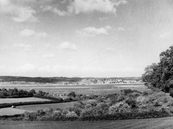 View across the River Exe to Exmouth and the coast of Devon, England. Date: 1962