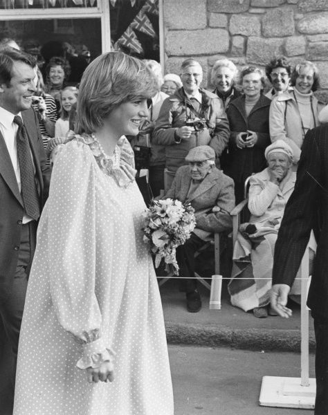 Diana, Princess of Wales (1961-1997) pregnant with William and wearing a polka dot maternity dress with frilled collar and cuffs in front of crowds while on a visit to St Mary's, Isles of Scilly