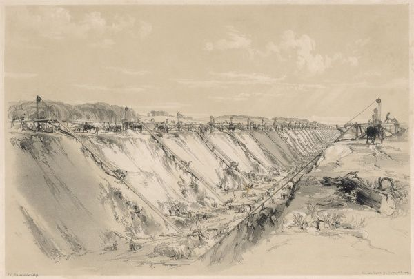 The construction of the Tring Cutting. Railway navvies dig out the earth and rock by hand with the spoil lifted up to the top of the bank by horse- powered winches