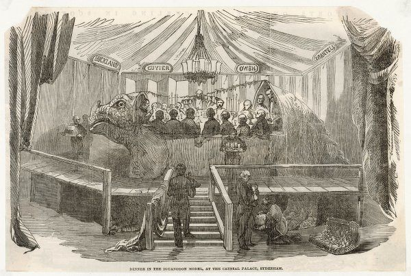 Hawkins invities scientists to dine inside his iguanodon model at the Crystal Palace exhibition at Sydenham