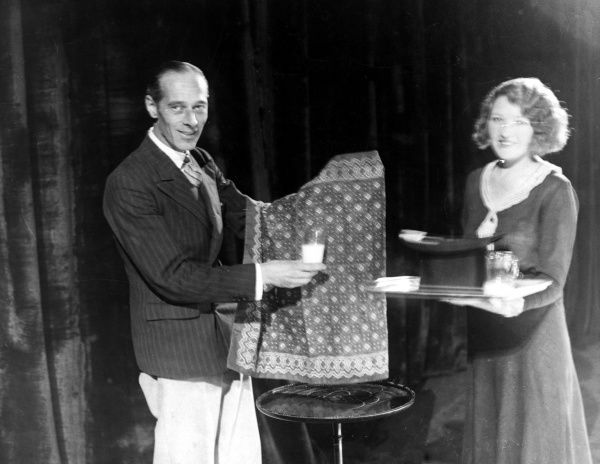 Magic at Maskelyne's : Magician Mr. Edward Victor, assisted by the lovely Miss Eileen O'Connor, demonstrated the amazing 'Disappearing Milk' trick! Date: 1930s