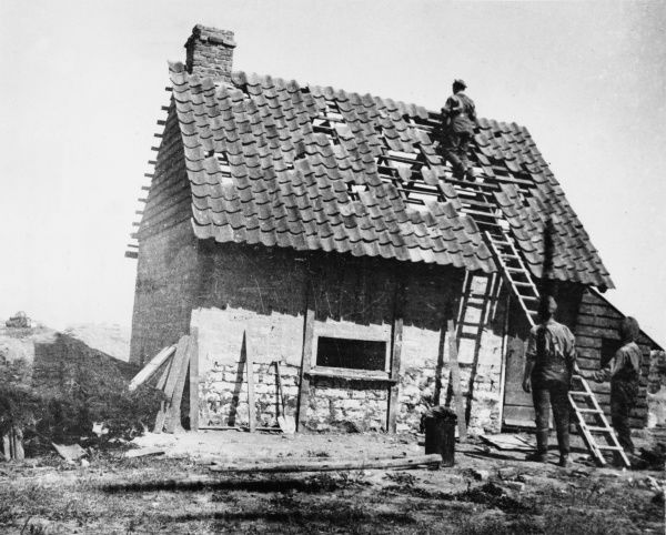 Concrete pill box near Poperinghe camouflaged as a ruined cottage on the Western Front in Belgium during World War I in August 1918