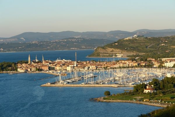 A distant view of the port and town of Izola, Slovenia, in the late afternoon