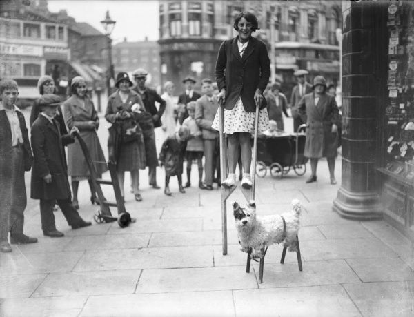 A girl on stilts and her amazing dog, also on stilts, cause quite a stir as they entertain a crowd in central London!