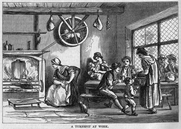 A dog works a kitchen turnspit above a fire