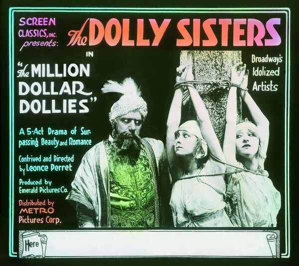 Advertising slide for the film The Million Dollar Dollies starring the Dolly Sisters, 1918