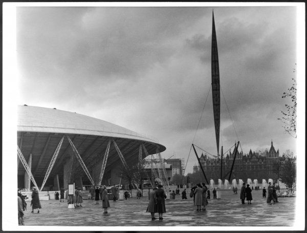 Visitors outside the Dome of Discovery and the Skylon, both famous attractions of the Festival of Britain exhibition, South Bank, London