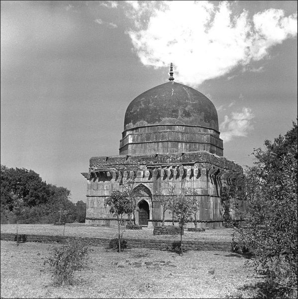 A domed building, possibly a tomb, in Mandu, Madhya Pradesh Province, Central India. Photograph by Ralph Ponsonby Watts