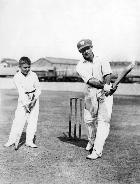 A boy receives a cricket lesson from his hero, the famous Australian cricketer Sir DON BRADMAN, ('The Don') who lived to a ripe old age, a 'good innings', indeed! Date: 1908 - 2001