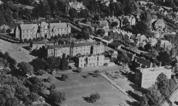 Aerial view of Dorking General Hospital on Horsham Road, Dorking, Surrey. Designed by William Shearburn, the building opened in 1841 as the Dorking Union workhouse. The original workhouse entrance block and main building are centre of the picture