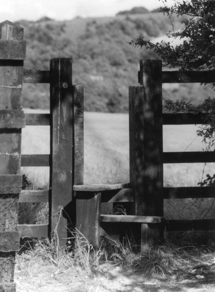 A double-step stile, Buckinghamshire, England. Date: 1930s