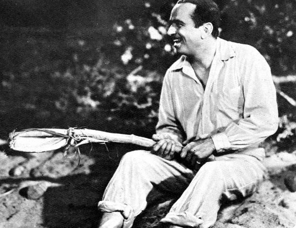 Photograph of Douglas Fairbanks (1883-1939) in A.Edward Sutherland's 'Mr. Robinson Crusoe', with one of the character's home-made weapons