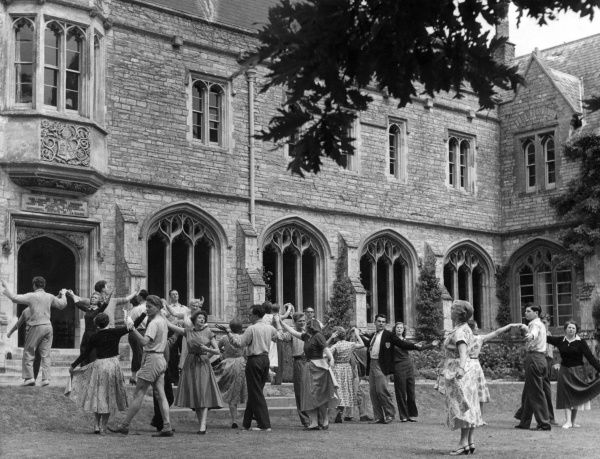 British Drama League summer school: men and women taking part in a class on 18th century movement, possibly in Oxford Date: circa 1955