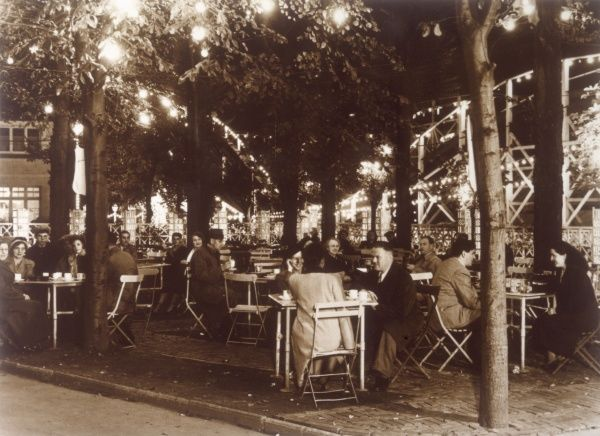 A summer's evening in the outdoor cafe at Dreamland Amusement Park, Margate