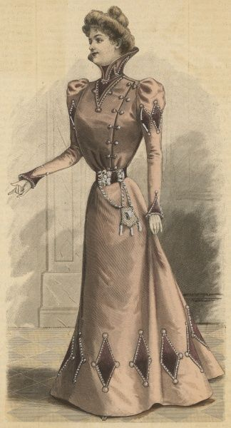 Wrap over bodice, high collar, tight sleeves with shoulder puff & reversed cuffs, diamond applique on the hem & sleeves. A reticule hangs from a broad belt with a silver buckle
