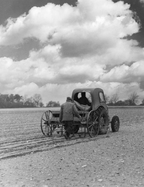 Drilling sugar beet on a farm in Norfolk, England. Date: 1950s