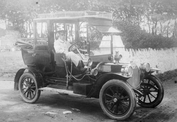 Mr E Codd of Bland Motors, driving a car made by the Star Motor Company, probably in Haverfordwest, Pembrokeshire, South Wales. J & G Bland (Motors) Ltd was established in 1875 and is still in existence today
