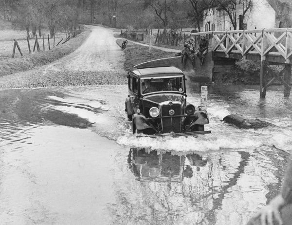 A car makes a splash at Barwick Ford, Hertfordshire, England