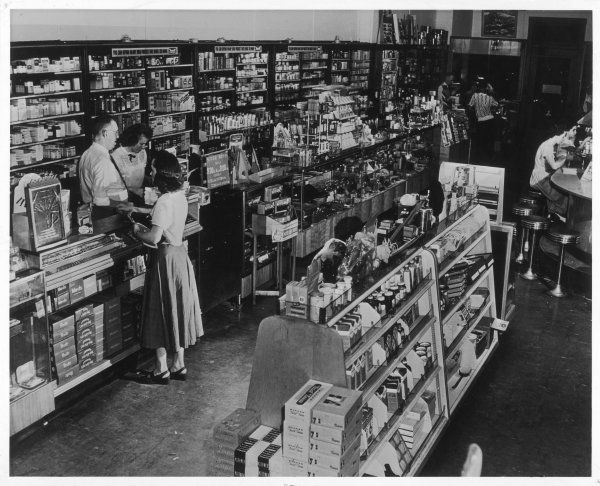 The well-stocked interior of a drugstore in an East Coast town in America complete with soda bar