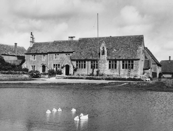 VILLAGE SCENE A peaceful scene at Ducklington, Oxfordshire, showing the school-house beside the duckpond