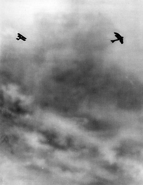 A French bi-plane in pursuit of a German A.E.G bi-plane in 1915