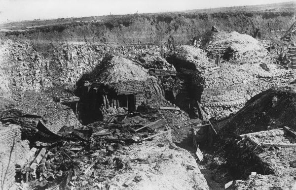 Dugouts cut into a hillside during the First World War. Date: 1918