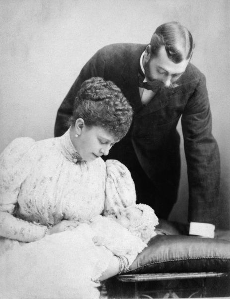Photograph of Prince George, Duke of York (later Prince of Wales, and then King George V) and the Duchess of York, (later Queen Mary) with their eldest son, Edward ('David'), later King Edward VIII and then Duke of Windsor in 1894