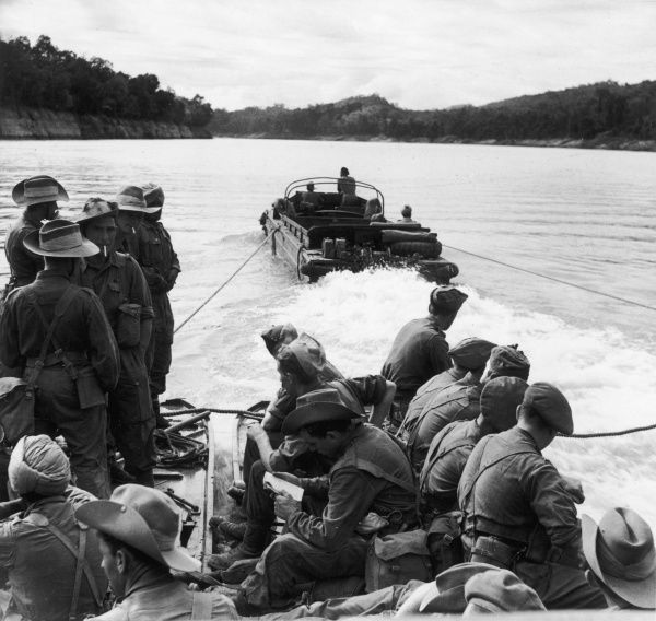 "DUKW powered ferry on the Great Chindwin River, Burma - circa 1945. The DUKW (popularly pronounced ""duck"") is a six-wheel-drive amphibious truck that was designed by General Motors Corporation during World War II for transporting goods"