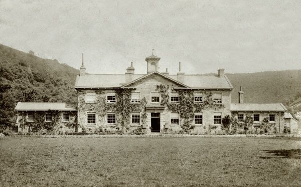 The former Dulverton Union workhouse erected in 1856 on Bridge Street, Dulverton. The building, designed by E Ashworth, now houses National Park offices. Date: 1918
