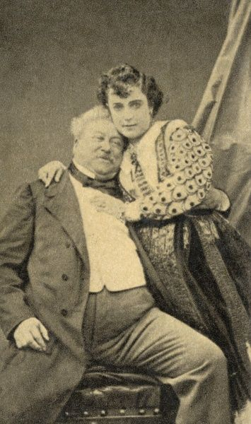 ALEXANDRE DUMAS (PERE) French author of 'Les trois mousquetaires' and 'Le comte de Monte-Cristo' among others, photographed with his wife (?) in 1865. Date: 1802 - 1870