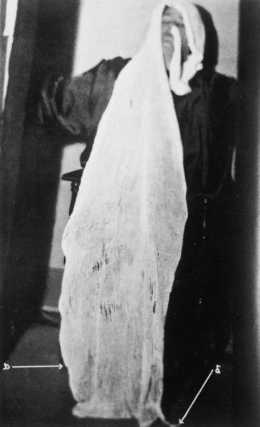 HELEN DUNCAN, tested by Harry Price, exudes a sheet of ectoplasmic material which closely resembles cheesecloth