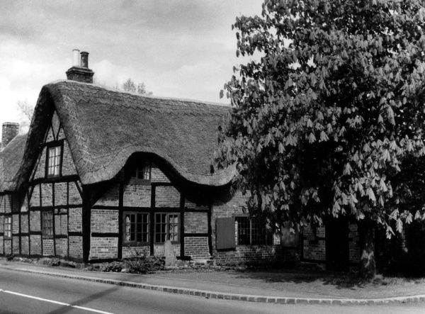 The Old Forge, Dunchurch, Warwickshire, England, reputed to be the original smithy on which Henry Wadsworth Longfellow based his poem 'The Village Blacksmith' (1842). Date: 1950s