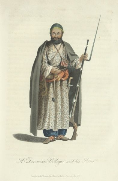 A Dooraunee Villager with his Arms. An Afghan man wearing a long cloak and carrying a firearm with a long bayonet